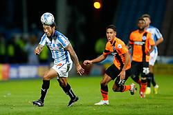 Sean Scannell of Huddersfield Town  is challenged by Adam Chicksen of Brighton - Photo mandatory by-line: Rogan Thomson/JMP - 07966 386802 - 21/10/2014 - SPORT - FOOTBALL - Huddersfield, England - The John Smith's Stadium - Huddersfield Town v Brighton & Hove Albion - Sky Bet Championship.