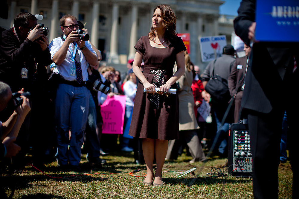 Rep. Michele Bachmann (R-MN) waits to speak at a Tea Party rally on Capitol Hill on Wednesday, April 6, 2011 in Washington. (Photo by Jay Westcott/Politico)