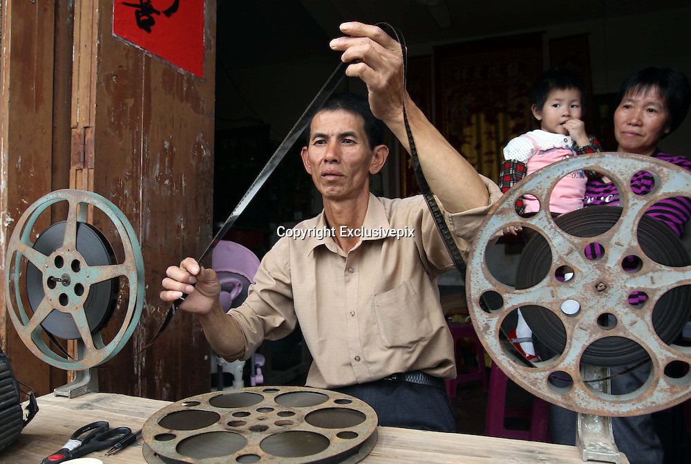 """ZHANGZHOU, CHINA - (CHINA OUT) <br /> <br /> """"Movie Theater"""" In Rural China <br /> <br /> Movie projectionist Qiu Wensheng prepares to show a movie for villagers  in Zhangzhou, Fujian Province of China. There are many movie projectionists working in rural areas to show movies for farmers. <br /> ©Exclusivepix"""