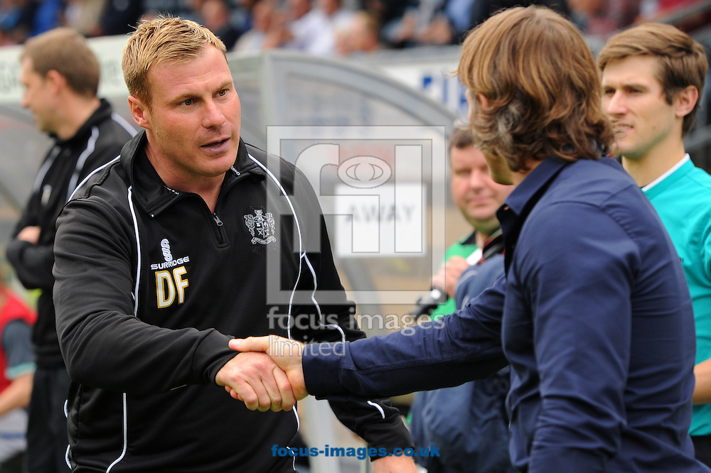 Gareth Ainsworth of Wycombe Wanderers and David Flitcroft of Bury shakes hands during the Sky Bet League 2 match at Adams Park, High Wycombe<br /> Picture by Seb Daly/Focus Images Ltd +447738 614630<br /> 06/09/2014