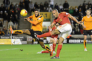 Nottingham Forest striker Chris O'Grady has a shot during the Sky Bet Championship match between Wolverhampton Wanderers and Nottingham Forest at Molineux, Wolverhampton, England on 11 December 2015. Photo by Alan Franklin.