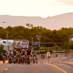 Forty Grand racers hit the pavement for a few miles as the sun rises over Grand Junction Saturday.<br /> Photos by Brian Leddy