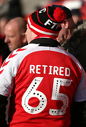 Close up of the back of a Fleetwood Town's shirt with the words 'Retired 65' before the game