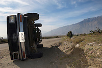 Rolled over truck in desert