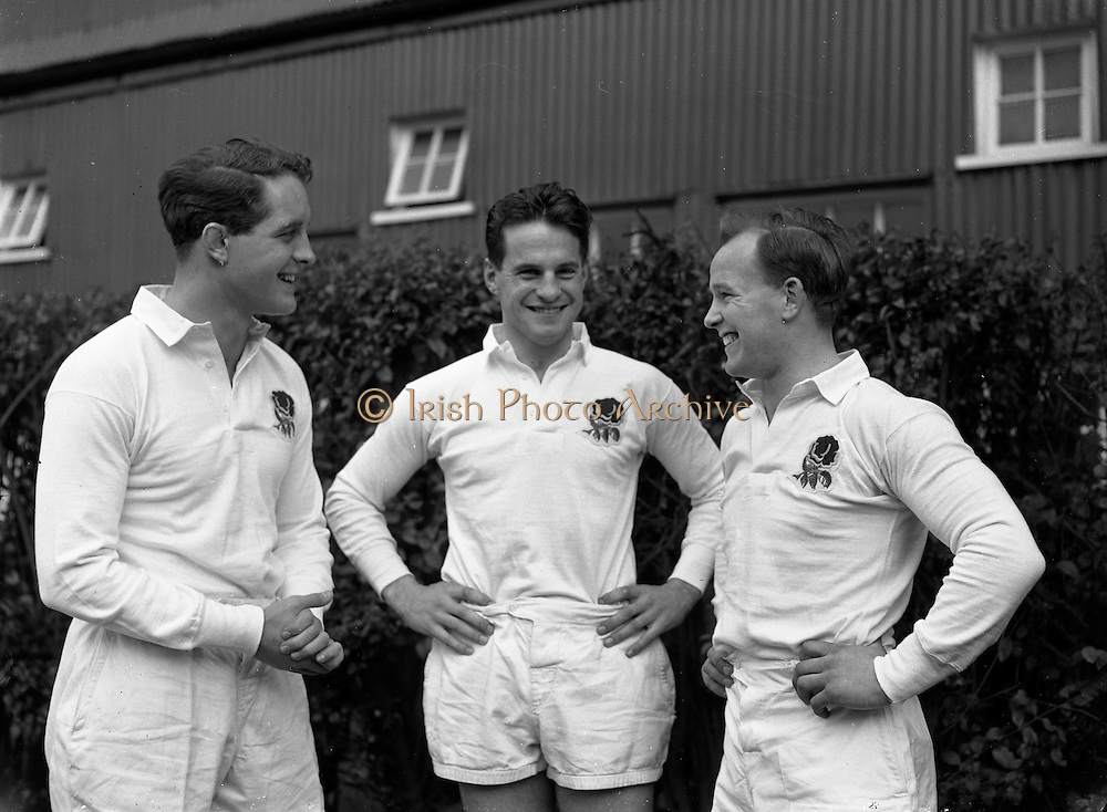 England players, J W Clements, Old Cranleighans, on the left, J G G Hetherington, Northhampton, in the centre, and R Jeeps, on the right, chatting before the start of the game against Ireland on Saturday 14th February, 1959, ..Irish Rugby Football Union, Ireland v England, Five Nations, Landsdowne Road, Dublin, Ireland, Saturday 14th February, 1959,.14.2.1959, 2.14.1959,..Referee- D Gwynne Walters, Welsh Rugby Union, ..Score- Ireland 0 - 3 England, ..Irish Team, ..N J Henderson, Wearing number 15 Irish jersey, Full back, N.I.F.C, Rugby Football Club, Belfast, Northern Ireland,..N H Brophy, Wearing number 14 Irish jersey, Right wing, University College Dublin Rugby Football Club, Dublin, Ireland, ..A J O'Reilly, Wearing number 13 Irish jersey, Right Centre, Old Belvedere Rugby Football Club, Dublin, Ireland, and, Leicester Rugby Football Club, Leicester, England, ..J F Dooley, Wearing  Number 12 Irish jersey, Left Centre, Galwegians Rugby Football Club, Galway, Ireland, ..A C Pedlow, Wearing number 11 Irish jersey, Left wing,  C I Y M S Rugby Football Club, Belfast, Northern Ireland, ..M A English, Wearing number 10 Irish jersey, Outside Half, Bohemians Rugby Football Club, Limerick, Ireland,..A A Mulligan, Wearing number 9 Irish jersey, Scrum Half, London Irish Rugby Football Club, Surrey, England, ..B G Wood, Wearing number 1 Irish jersey, Forward, Garryowen Rugby Football Club, Limerick, Ireland, ..A R Dawson, Wearing number 2 Irish jersey, Captain of the Irish team, Forward, Wanderers Rugby Football Club, Dublin, Ireland, ..S Millar, Wearing number 3 Irish jersey, Forward, Ballymena Rugby Football Club, Antrim, Northern Ireland,..W A Mulcahy, Wearing number 4 Irish jersey, Forward, University College Dublin Rugby Football Club, Dublin, Ireland, ..M G Culliton, Wearing number 5 Irish jersey, Forward, Wanderers Rugby Football Club, Dublin, Ireland, ..N A Murphy, Wearing number 6 Irish jersey, Forward, Cork Constitution Rugby Football Club, Cork, Ireland,..P J A O'