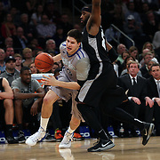 Doug McDermott, Creighton, drives past LaDontae Henton, Providence, during the Creighton Bluejays Vs Providence Friars basketball game during the Big East Conference Tournament Final at Madison Square Garden, New York, USA. 15th March 2014. Photo Tim Clayton