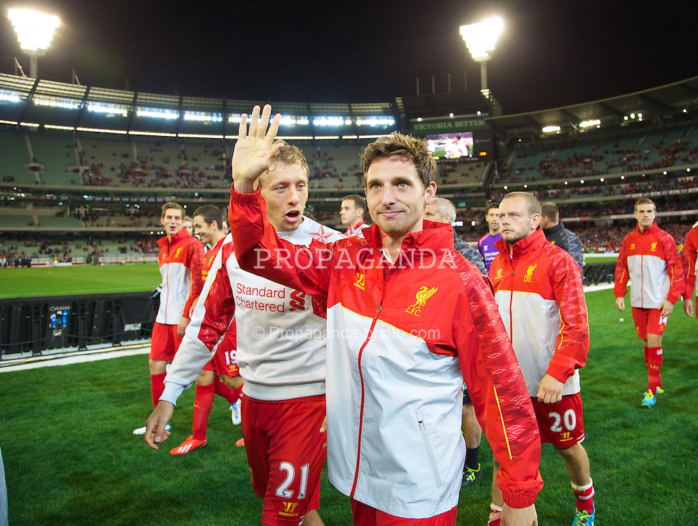 MELBOURNE, AUSTRALIA - Wednesday, July 24, 2013: Liverpool's Joe Allen waves to the supporters after his side's 2-0 victory over Melbourne Victory during a preseason friendly match at the Melbourne Cricket Ground. (Pic by David Rawcliffe/Propaganda)