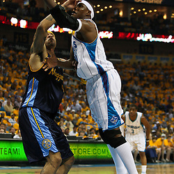 25 April 2009: New Orleans Hornets forward James Posey (41) shoots and scores over Denver Nuggets forward Kenyon Martin (4) during a NBA Western Conference quarter-finals playoff game between the New Orleans Hornets and the Denver Nuggets at the New Orleans Arena in New Orleans, Louisiana.