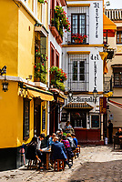 Outdoor dining in Plaza Venerables, along Calle Jamerdana in the old part of Seville, Andalusia, Spain.
