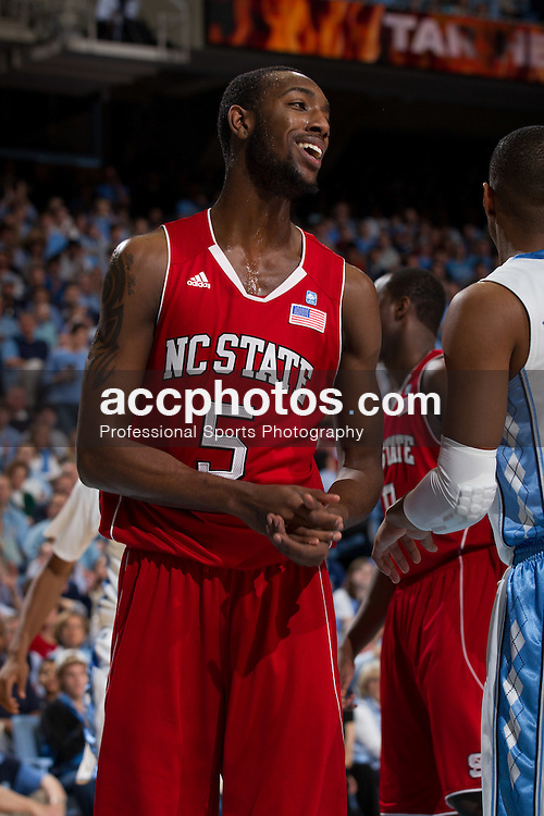 CHAPEL HILL, NC - JANUARY 29: C.J. Leslie #5 of the North Carolina State Wolfpack laughs after his team fouls while playing the North Carolina Tar Heels on January 29, 2011 at the Dean E. Smith Center in Chapel Hill, North Carolina. North Carolina won 84-64. (Photo by Peyton Williams/UNC/Getty Images)  *** Local Caption *** C.J. Leslie
