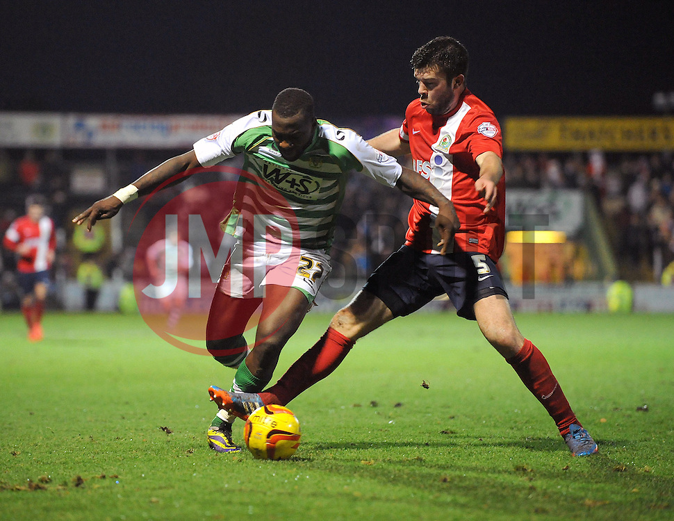 Yeovil Town's Ishmael Miller is challenged by Blackburn Rovers' Grant Hanley - Photo mandatory by-line: Dougie Allward/JMP - Tel: Mobile: 07966 386802 21/12/2013 - SPORT - FOOTBALL - Huish Park - Yeovil - Yeovil Town v Blackburn Rovers - Sky Bet Championship