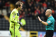 Notts County goalkeeper Roy Carroll (Capt) talks with referee Andy Woolmer during the Sky Bet League 2 match between Notts County and Leyton Orient at Meadow Lane, Nottingham, England on 20 February 2016. Photo by Jon Hobley.