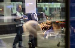 12.09.2015, Hauptbahnhof Salzburg, AUT, Fluechtlinge am Hauptbahnhof Salzburg auf ihrer Reise nach Deutschland, im Bild ein Flüchtlingspaar wartet auf die Abfahrt des Zuges nach Muenchen. Der ÖBB Zugsverkehr nach Deutschland wurde eingestellt // a fugitive couple waiting for the departure of the train to Munich. According to reports Germany has stoped the Train Traffic from and into Austria, Main Train Station, Salzburg, Austria on 2015/09/12. EXPA Pictures © 2015, PhotoCredit: EXPA/ JFK