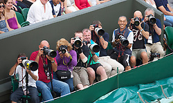 LONDON, ENGLAND - Tuesday, June 29, 2010: Photographers during the Ladies' Invitation Doubles match on day eight of the Wimbledon Lawn Tennis Championships at the All England Lawn Tennis and Croquet Club. (Pic by David Rawcliffe/Propaganda)