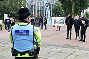 Police watch during the Black Lives Matter protest at Queens Gardens, Hull, United Kingdom on 10 June 2020.