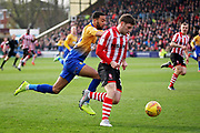 Lincoln City Shay McCartan(17) on the attack during the EFL Sky Bet League 2 match between Lincoln City and Mansfield Town at Sincil Bank, Lincoln, United Kingdom on 24 November 2018.