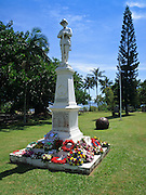 Flower wreaths on statue in ANZAC Park, Port Douglas during ANZAC Day Parade 2009.