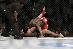 Dec 12, 2009; Memphis, TN, USA; Heavyweights Cheick Kongo and Frank Mir during their bout at UFC 107 at the FedEx Forum in Memphis, TN.  Mir won via 1st round guillotine choke over Cheick Kongo.