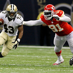 September 23, 2012; New Orleans, LA, USA; New Orleans Saints running back Darren Sproles (43) runs from Kansas City Chiefs linebacker Tamba Hali (91) during the second quarter of a game at the Mercedes-Benz Superdome. Mandatory Credit: Derick E. Hingle-US PRESSWIRE