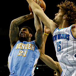 Mar 25, 2013; New Orleans, LA, USA; Denver Nuggets shooting guard Wilson Chandler (21) shoots as New Orleans Hornets center Robin Lopez (15) defends during the second half of a game at the New Orleans Arena. The Hornets defeated the Nuggets 110-86. Mandatory Credit: Derick E. Hingle-USA TODAY Sports
