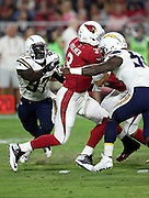 Arizona Cardinals quarterback Carson Palmer (3) gets pressured in the first quarter by San Diego Chargers outside linebacker Jeremiah Attaochu (97) and sacked by San Diego Chargers outside linebacker Melvin Ingram (54) as he drops back to pass during the 2015 NFL preseason football game against the San Diego Chargers on Saturday, Aug. 22, 2015 in Glendale, Ariz. The Chargers won the game 22-19. (©Paul Anthony Spinelli)