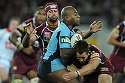 May 25th 2011: Akuila Uate of the Blues is tackled during game 1 of the 2011 State of Origin series at Suncorp Stadium in Brisbane, Australia on May 25, 2011. Photo by Matt Roberts/mattrIMAGES.com.au / QRL