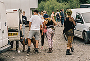 Ravers in boots near white vans, Halfway Quarry Brecon Wales, May 2017