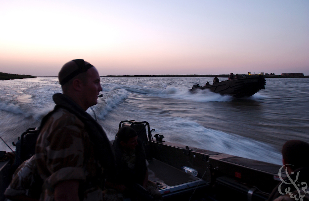 Royal Artillery 38 Battery 40 Regiment Bombadier Naylor Ewen, from Camberley, England rides in a British Army patrol boat to conduct a September 6, 2003 lookout for smugglers down the Shatt al-Arab river near Basra, Iraq. 15 British sailors and Marines were captured on Friday, March 23, 2007 by Iranian forces in this waterway leading to the Persian Gulf and then released after 12 days in what became a large international diplomatic incident.