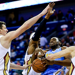 Mar 31, 2016; New Orleans, LA, USA; New Orleans Pelicans forward Luke Babbitt (8) strips the ball from Denver Nuggets forward Kenneth Faried (35) as forward Dante Cunningham (44) and center Omer Asik (3) defend during the first quarter of a game at the Smoothie King Center. Mandatory Credit: Derick E. Hingle-USA TODAY Sports