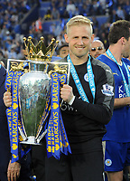 Football - 2015 / 2016 Premier League - Leicester City vs. Everton<br /> <br /> Kasper Schmeichel of Leicester with the trophy at the King Power Stadium.<br /> <br /> COLORSPORT/ANDREW COWIE