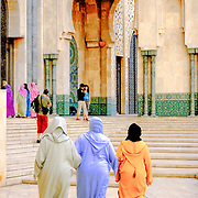 Three Muslim woman in traditional dress at Hassan II Mosque, Casablanca. The mosque is the 2nd largest in the world behind Mecca and the only mosque in Morocco open to non Muslims. The minaret is 210 meters tall, the world's tallest.