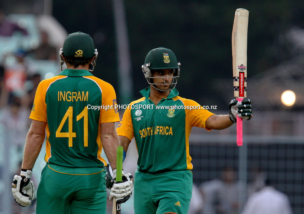 South African batsman JP Duminy celebrates half century against Ireland during the ICC Cricket World Cup - 34th Match, Group B South Africa vs Ireland Played at Eden Gardens, Kolkata, 15 March 2011 - day/night