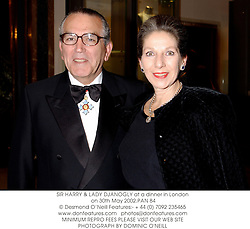 SIR HARRY & LADY DJANOGLY at a dinner in London on 30th May 2002.			PAN 84