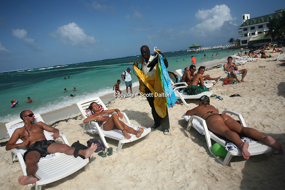 A local tries to sell items to tourists on the beach in San Andres, a small island in the Caribbean, on Thursday, January 24, 2008. San Andres belongs to Colombia, although the territory and water rights have long been disputed with Nicaragua. But now there is a movement among the local population, who call themselves Raizal, mainly of African decent, calling for independence. (Photo/Scott Dalton).