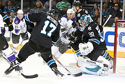 November 15, 2010; San Jose, CA, USA;  San Jose Sharks center Torrey Mitchell (17) clears the puck in front of goalie Antero Niittymaki (30) and Los Angeles Kings right wing Justin Williams (14) during the first period at HP Pavilion. Mandatory Credit: Jason O. Watson / US PRESSWIRE