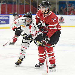 WHITBY, - Dec 13, 2015 -  WJAC Game 2- Team Switzerland vs Team Canada East at the 2015 World Junior A Challenge at the Iroquois Park Recreation Complex, ON. Yannick Lerch #18 of Team Switzerland battles for control with Josh Dickinson #15 of Team Canada East during the first period.(Photo: Andy Corneau / OJHL Images)
