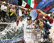 CULIACAN, MEXICO - FEBRUARY 3, 2017: Teammates shower Sebastian Valle #52 of Mexico, as well as a member of the media, in sports drink, after he hits a walk-off grand slam during the Caribbean Series game against Venezuela at Estadio de los Tomateros at Estadio de los Tomateros at Estadio de los Tomateros on February 3, 2017 in Culiacan, Rosales. (Photo by Jean Fruth)