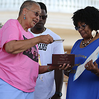 Councilwoman Nettie Davis presents the key to the city to Lee Williams wife, Annie Ruth, Saturday at his birthday celebration at Fair Park