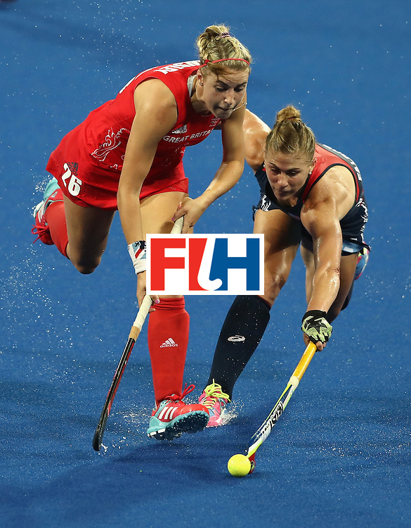 RIO DE JANEIRO, BRAZIL - AUGUST 13:  Lily Owsley (L) of Great Britain takes on Katelyn Falgowski during the Women's group B hockey match between Great Britain and the USA on Day 8 of the Rio 2016 Olympic Games at the Olympic Hockey Centre on August 13, 2016 in Rio de Janeiro, Brazil.  (Photo by David Rogers/Getty Images)