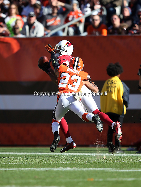 Arizona Cardinals wide receiver Michael Floyd (15) catches a 60 yard over the shoulder pass for a third quarter touchdown that cuts the Cleveland Browns lead to 20-17 while covered by Cleveland Browns cornerback Joe Haden (23) during the 2015 week 8 regular season NFL football game against the Cleveland Browns on Sunday, Nov. 1, 2015 in Cleveland. The Cardinals won the game 34-20. (©Paul Anthony Spinelli)