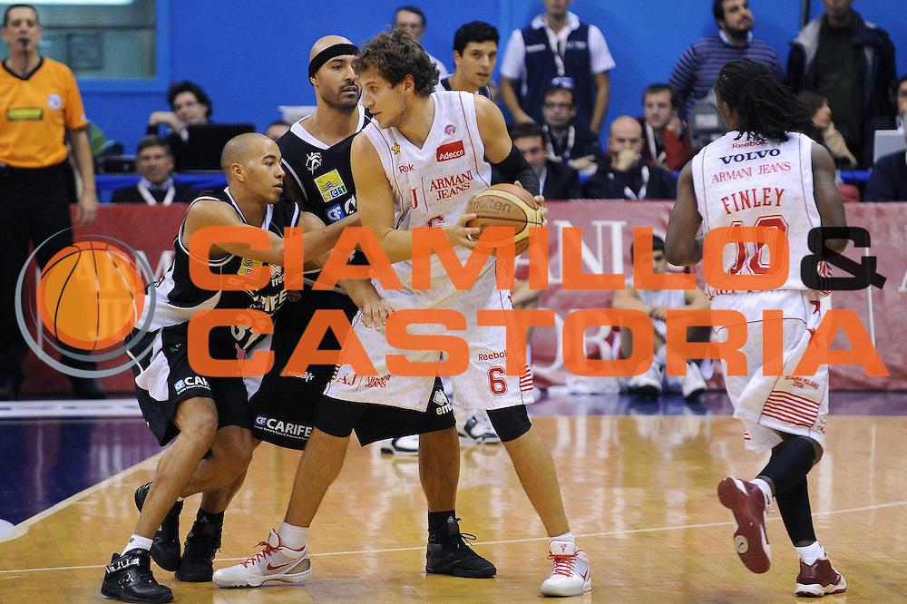 DESCRIZIONE : Milano Lega A 2009-10 Armani Jeans Milano Carife Ferrara<br /> GIOCATORE : Stefano Mancinelli<br /> SQUADRA : Armani Jeans Milano<br /> EVENTO : Campionato Lega A 2009-2010<br /> GARA : Armani Jeans Milano Carife Ferrara<br /> DATA : 18/10/2009<br /> CATEGORIA : Palleggio<br /> SPORT : Pallacanestro<br /> AUTORE : Agenzia Ciamillo-Castoria/A.Dealberto