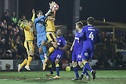 Sutton United Matt Tubbs (28) challenges AFC Wimbledon goalkeeper James Shea (1) during the The FA Cup third round replay match between AFC Wimbledon and Sutton United at the Cherry Red Records Stadium, Kingston, England on 17 January 2017. Photo by Stuart Butcher.