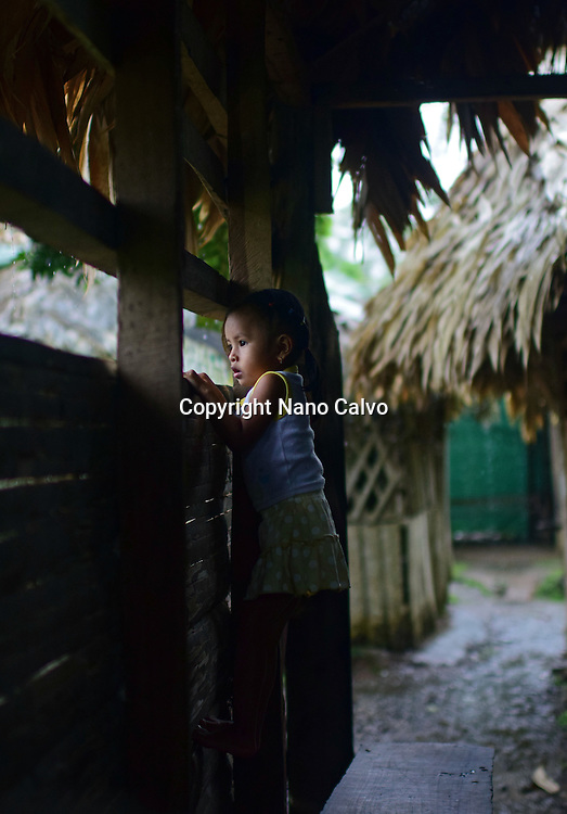 Portrait of a Bribri young girl (Adriana) inside a cottage. <br /> <br /> A day with the Bribri, indigenous people in Lim&oacute;n Province of Costa Rica