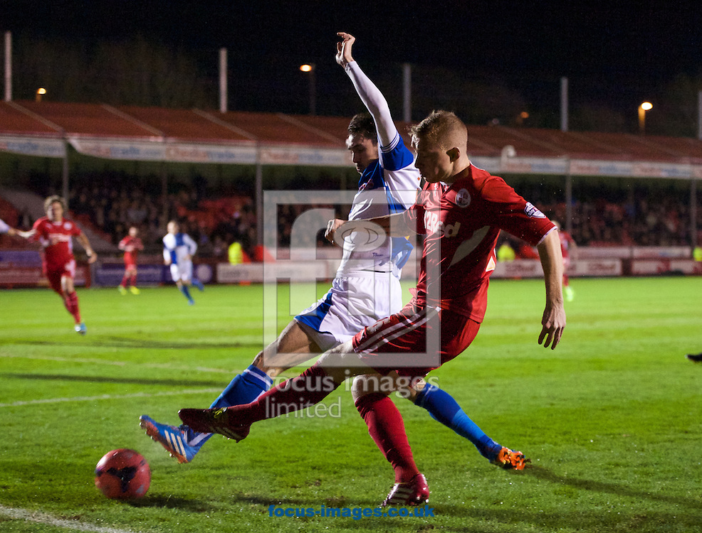 Picture by Alan Stanford/Focus Images Ltd +44 7915 056117<br /> 08/01/2014<br /> Jamie Proctor of Crawley Town puts in a cross during the The FA Cup match at Broadfield Stadium, Crawley.