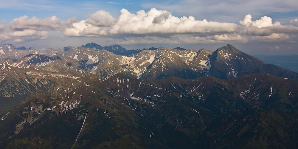 Aerial view of the Liptovske kopi of the Western Tatras and the High Tatras in the background. Western Tatras, Slovakia. June 2009. Mission: Ticha