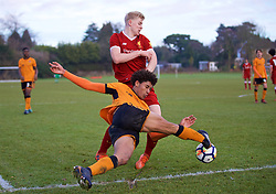 WOLVERHAMPTON, ENGLAND - Tuesday, December 19, 2017: Liverpool's substitute Luis Longstaff and Wolverhampton Wanderer's Dion Sanderson during an Under-18 FA Premier League match between Wolverhampton Wanderers and Liverpool FC at the Sir Jack Hayward Training Ground. (Pic by David Rawcliffe/Propaganda)