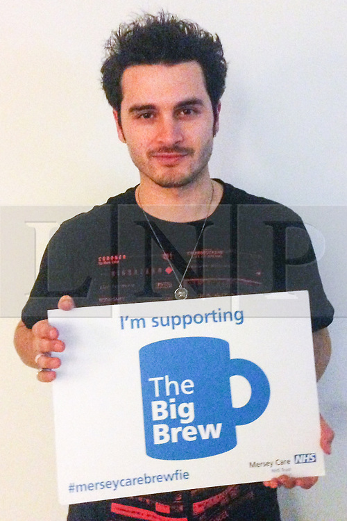 "© Licensed to London News Pictures . 19/01/2015 . Liverpool , UK . Michael Malarkey from The Vampire Diaries . Celebrities pose with "" Big Brew "" placards in support of mental health awareness as today (19th January 2015) marks "" Blue Monday "" , the day regarded by many as the most depressing in the year . Campaigners are urging the public to show support by tweeting sefies with their favourite brew and the hashtag "" #brewfie "" . In London , Deputy Prime Minister Nick Clegg , is announcing his campaign to improve mental health awareness , reduce stigma and promote a "" zero ambition "" target for suicide . Photo credit : Joel Goodman/LNP"