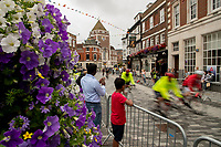 Riders pass a flower display in Kingston-Upon-Thames. The Prudential RideLondon Sportives. Sunday 29th July 2018<br /> <br /> Photo: Ben Queenborough for Prudential RideLondon<br /> <br /> Prudential RideLondon is the world's greatest festival of cycling, involving 100,000+ cyclists - from Olympic champions to a free family fun ride - riding in events over closed roads in London and Surrey over the weekend of 28th and 29th July 2018<br /> <br /> See www.PrudentialRideLondon.co.uk for more.<br /> <br /> For further information: media@londonmarathonevents.co.uk