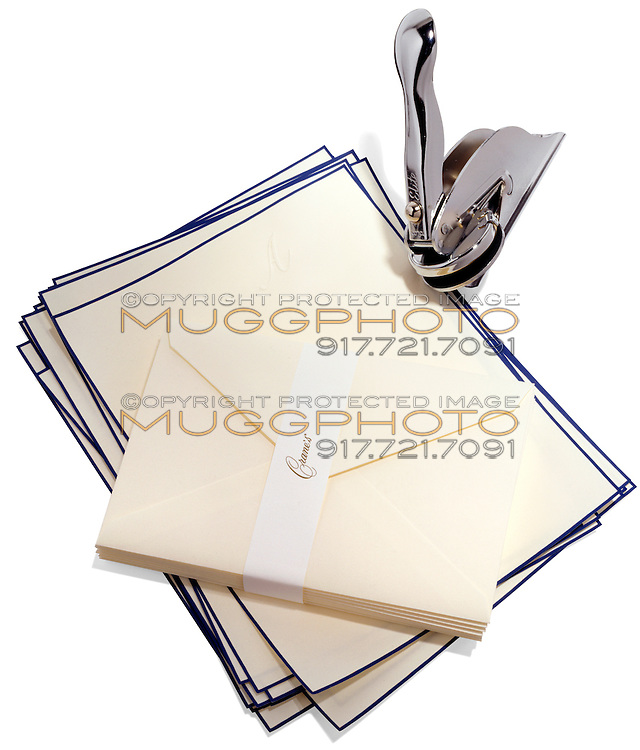 elite embosser and crane and co stationary on white background
