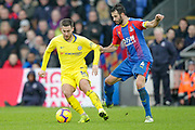 Chelsea midfielder Eden Hazard (10) has his shirt pulled by Crystal Palace midfielder Luka Milivojevic (4) during the Premier League match between Crystal Palace and Chelsea at Selhurst Park, London, England on 30 December 2018.